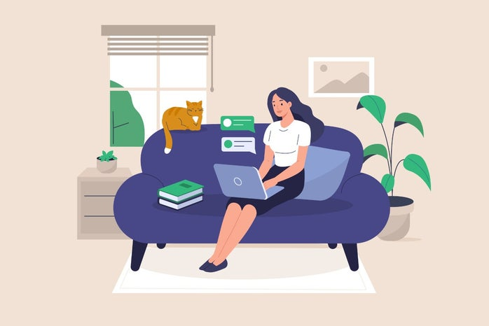 Freelance Girl Working at Home Sitting on Sofa with Laptop and Cat
