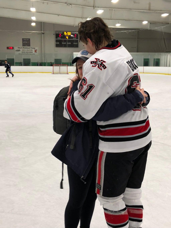 Hugging hockey player