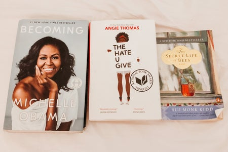 reading books: becoming by michelle obama, the hate u give by angie thomas, the secret life of bees by sue kidd