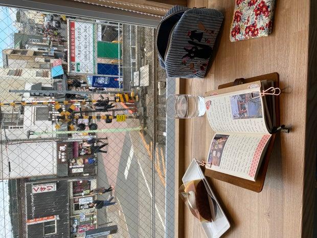 journaling at coffeeshop outside of fushimi inari shrines, travel