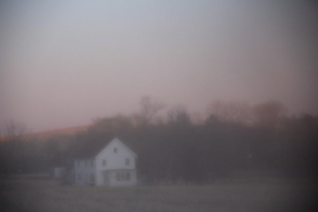 Hazy farm house in fog.