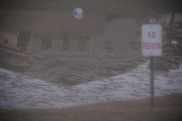 A no trespassing sign near a pond.