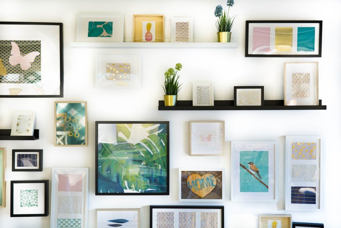 assorted framed images on a wall