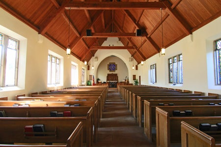 inside of church with wooden beams