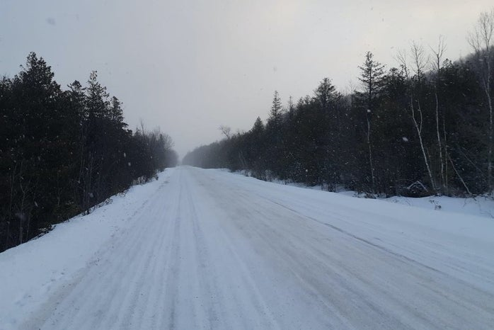 Snowy canadian road in the evening