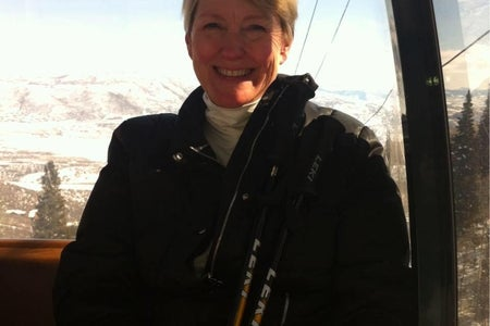 woman smiling on a ski lift