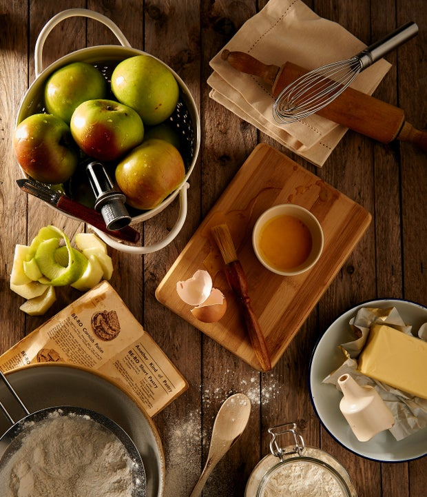 Ingredients for baking a pie on a wooden countertop