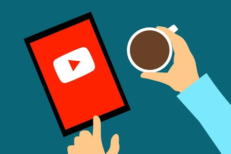 Illustration of YouTube on a device with coffee.