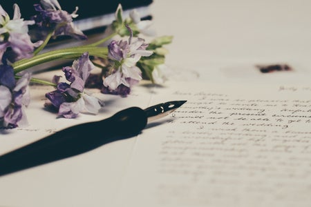purple flowers on letter paper with fountain pen and handwriting