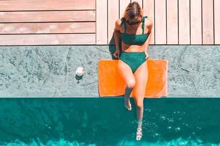 girl in green swimsuit by the pool