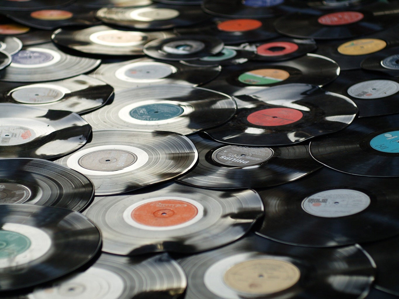 a pile of vinyl records