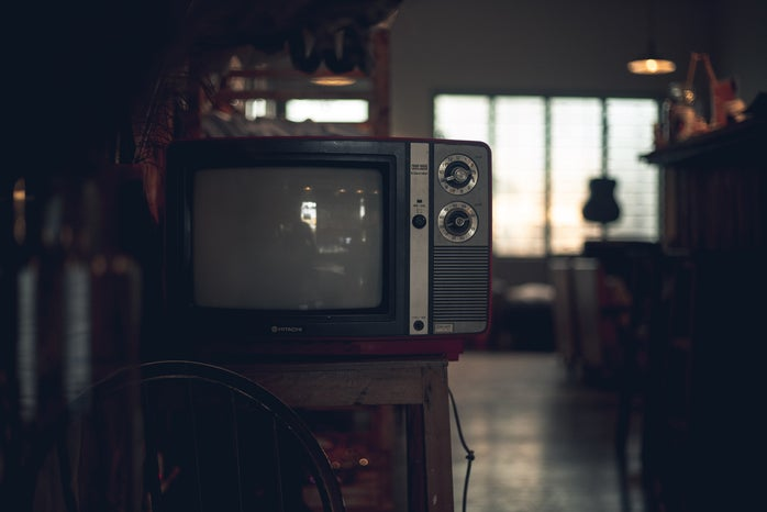 Old television from the 90s on a small table