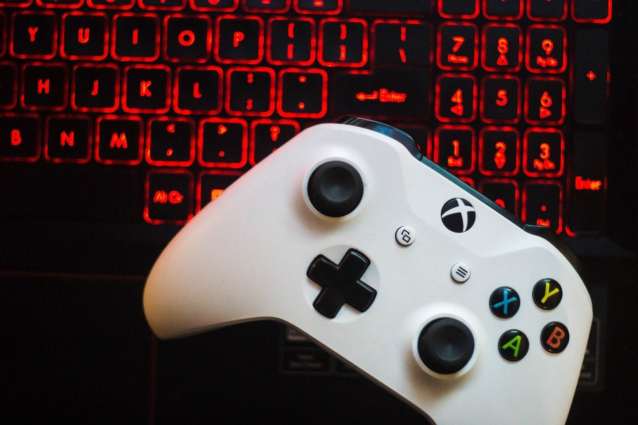 xbox controller on a red keyboard