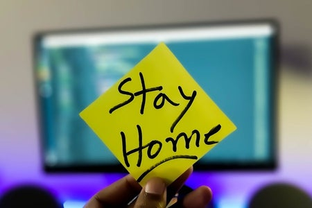 "sticky note that has ""Stay home"" written on it"