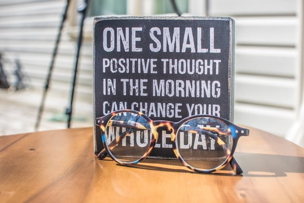 sign with positive messageand eyeglass