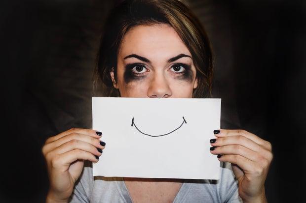 person holding white printer paper, mental health