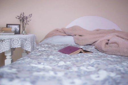 Cozy Bed with Book