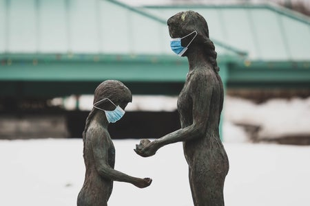 statues with face masks