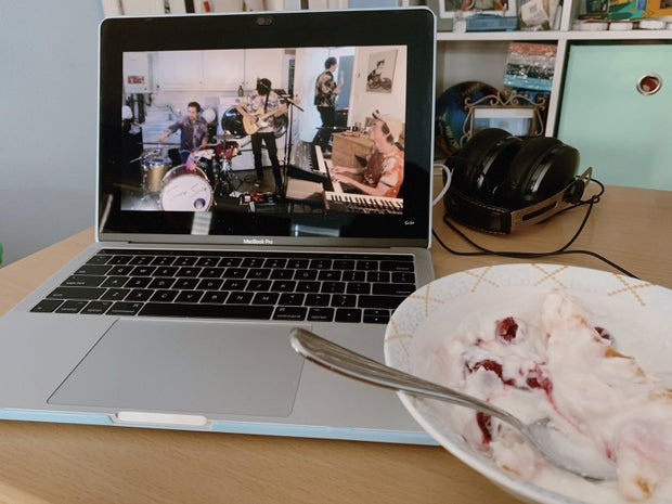 concert being streamed on a computer with a bowl of yogurt on the side