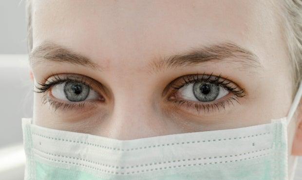 closeup of woman wearing a mask