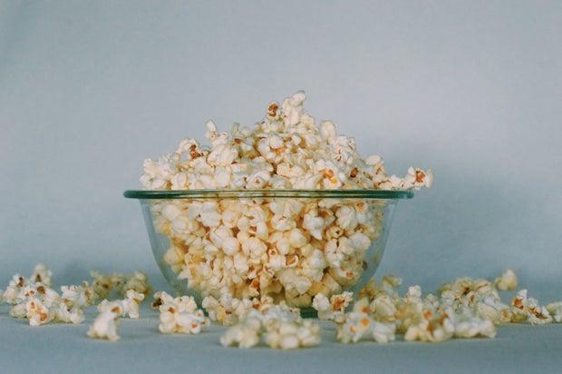 A glass bowl of popcorn