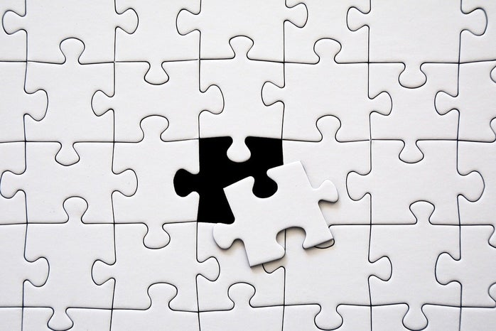 the last puzzle piece being placed into the puzzle