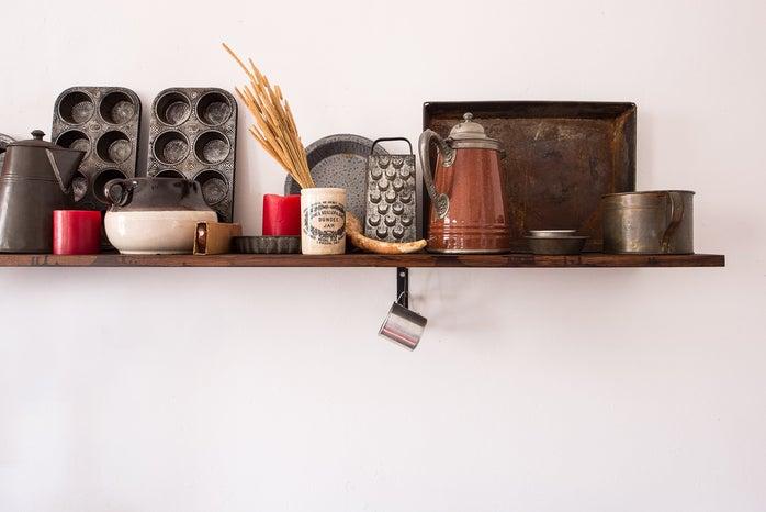 kitchen utensils on a shelf