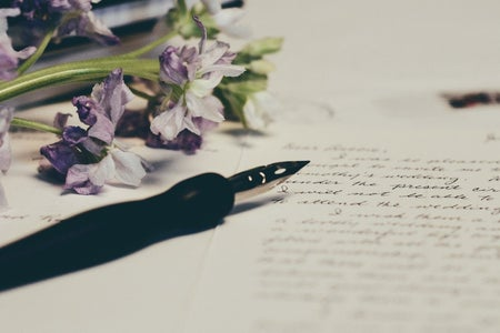 letter with flowers and pen