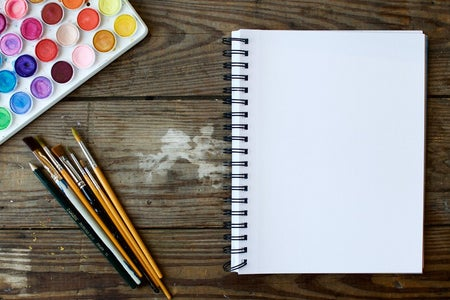 open notebook with watercolors