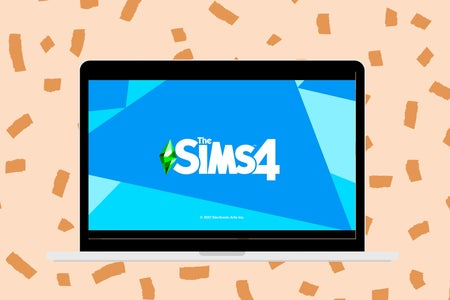 laptop with sims 4 on the screen