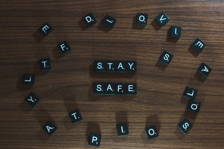Black and white stay safe letters