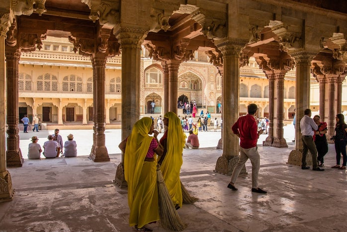 People walking through a building in India