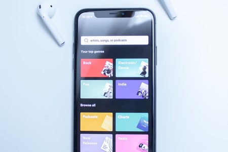 A black phone open to the Spotify app