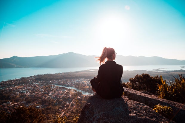 girl sitting with nature, mountains