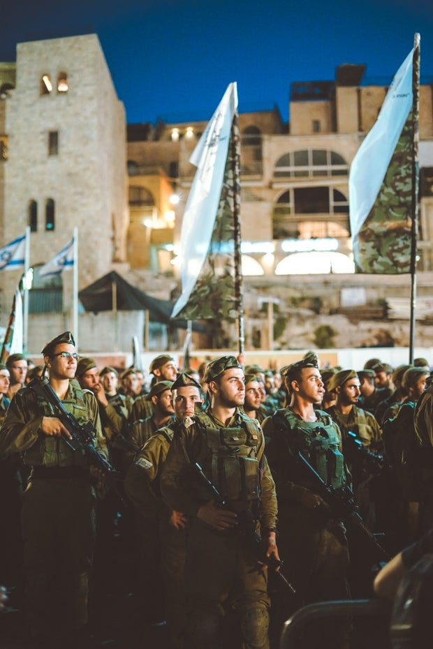 Israel Defense Force standing in a large group in the streets of Jerusalem