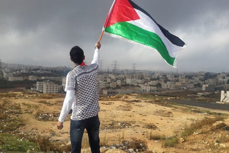 Man waving a Palestinian flag