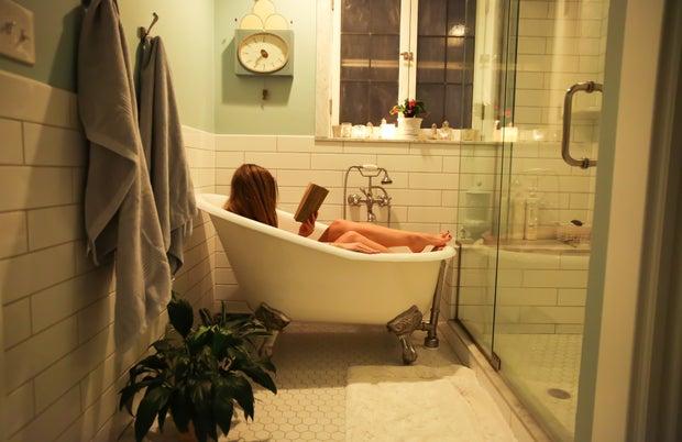 girl reading in a bath