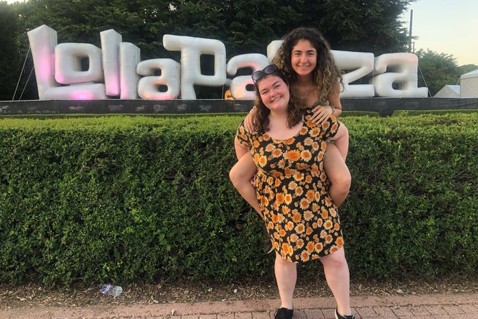 my friend and I standing in front of the Lolla sign
