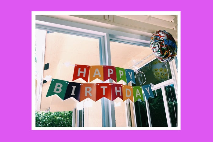 Birthday banner inside home with pink background