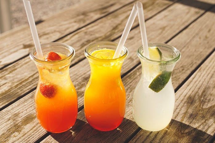 Three glasses of juice on a table