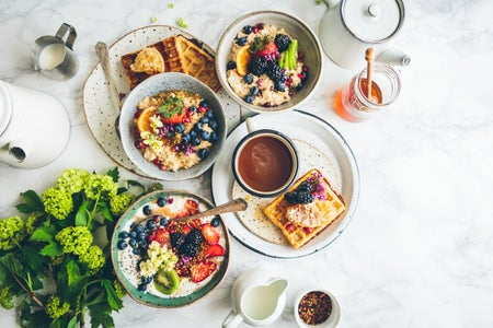 brunch spread with breakfast, coffee, and flowers