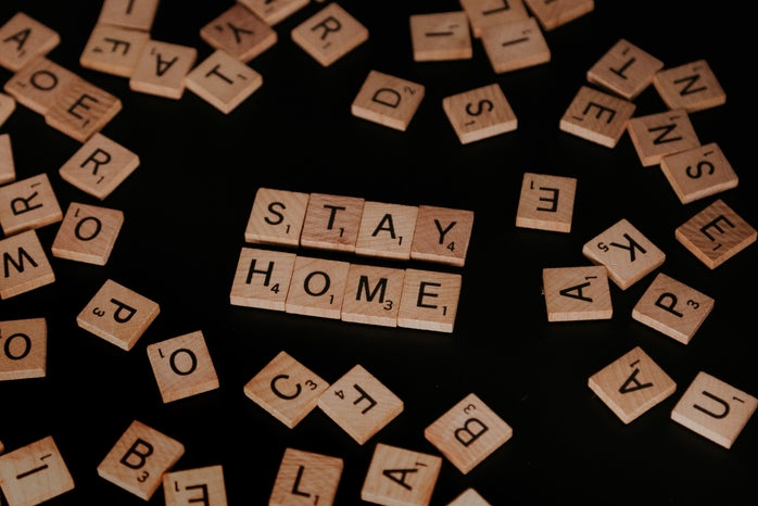 """scrabble pieces spelling out \""""stay home\"""""""