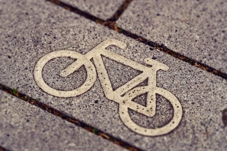 a bike drawn on a sidewalk