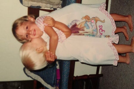 my cousin & i hugging as children