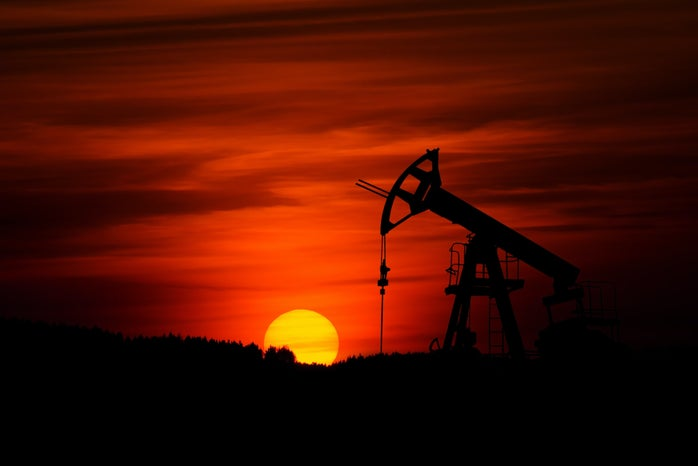 Oil pump in front of a sunset