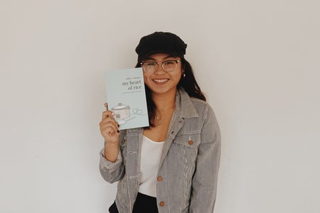 women author with her book