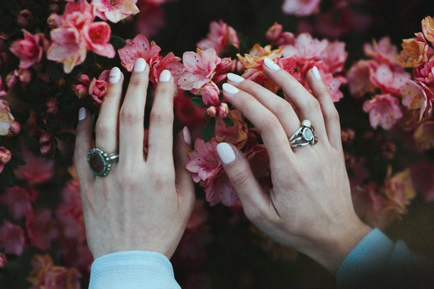 White nails against pink flowers