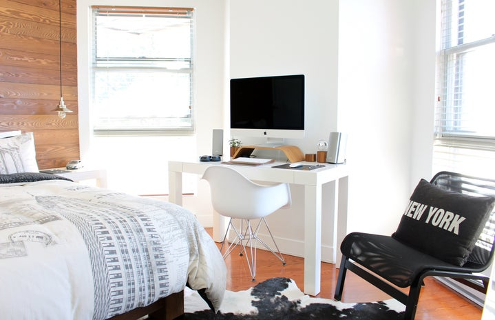 bright white bedroom with desk working space