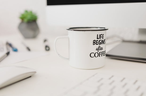 white coffee mug on desk