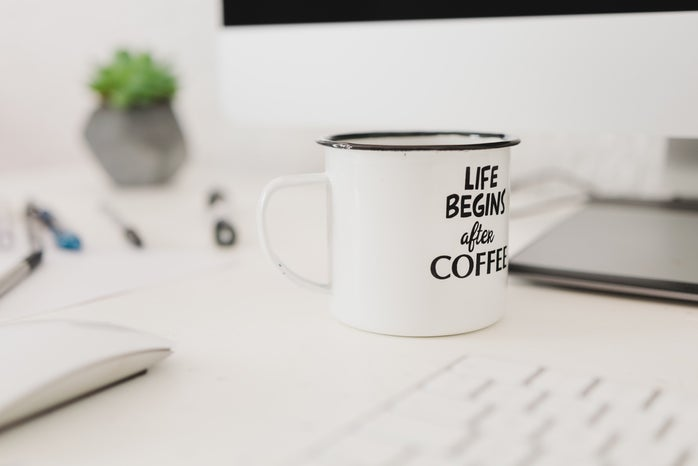 white coffee mug on desk